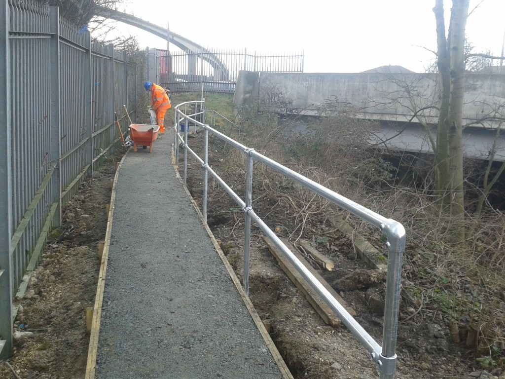 Handrail in place. The GRP wheelbarrow is non-conductive to protect workers from electricity