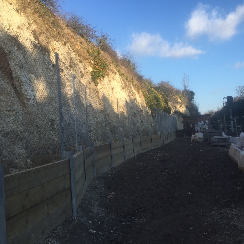 A substantial retaining wall was needed to protect the working area and the railway line from stones falling from the chalk cliff